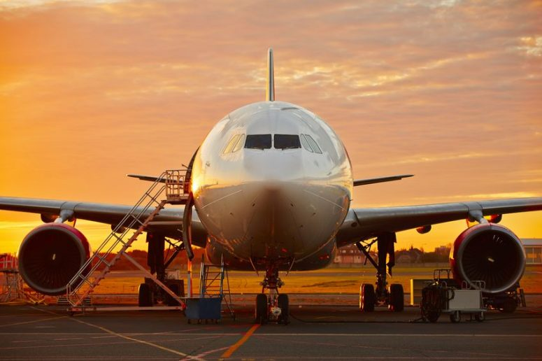 33003791 - aircraft service - large aircraft at the beautiful sunrise